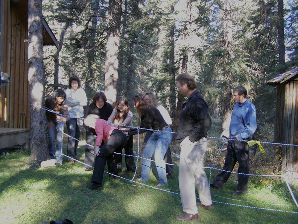 Group activity involving rope obstacle course.